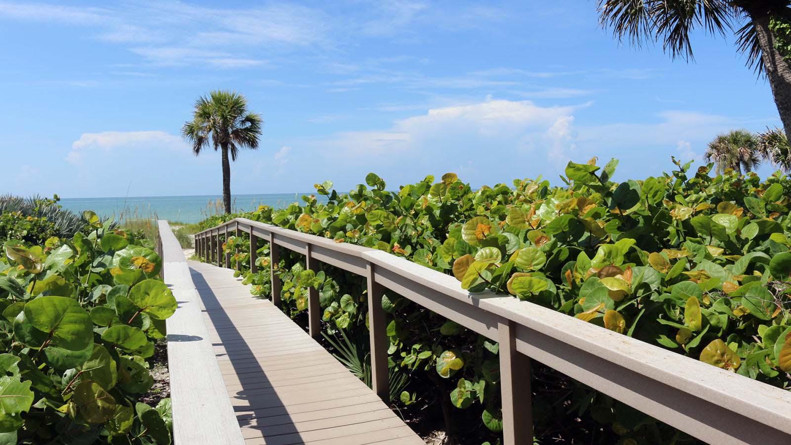 sanibel condo rentals poinciana boardwalk island vacations of sanibel captiva. Black Bedroom Furniture Sets. Home Design Ideas