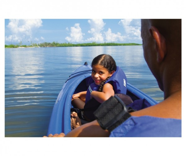 Young girl in kayak with her father