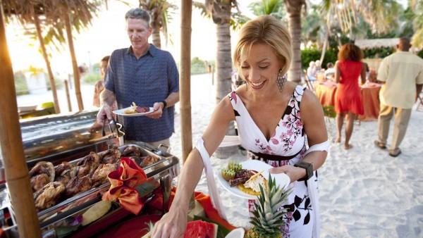 couple enjoying an island buffet