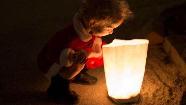 little child looking at luminary bag