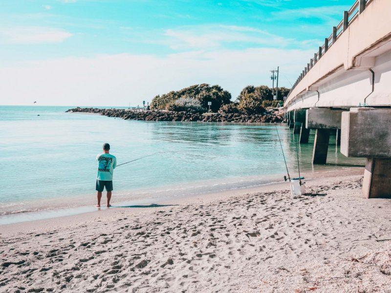 man at blind pass fishing sanibel